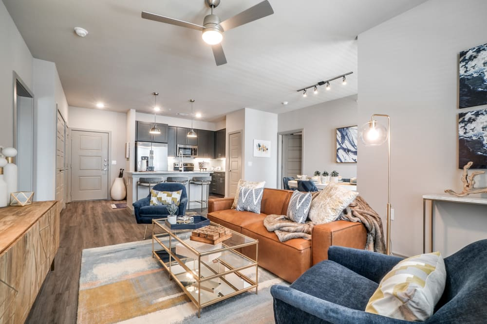 Living room with wood style flooring at One90 Firewheel in Garland, Texas