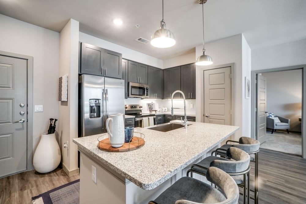 Bright kitchen at One90 Firewheel in Garland, Texas