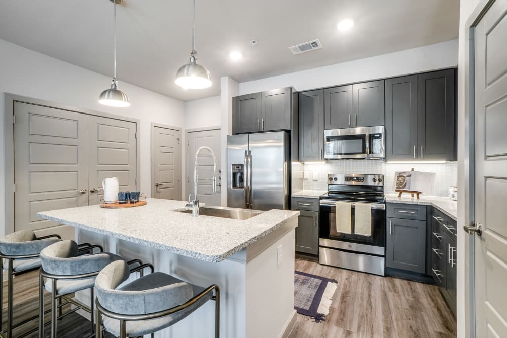 Fully equipped kitchen at One90 Firewheel in Garland, Texas