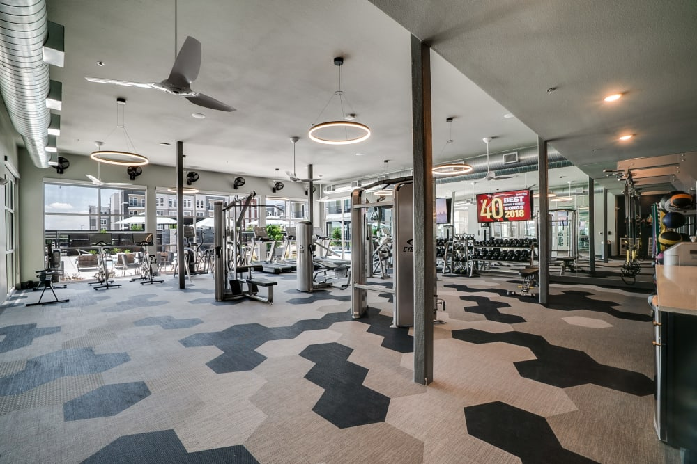 Fully equipped fitness center at One90 Firewheel in Garland, Texas