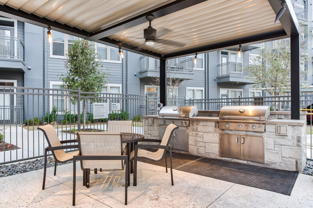 Outdoor grill area at Two99 Monroe in Roanoke, Texas