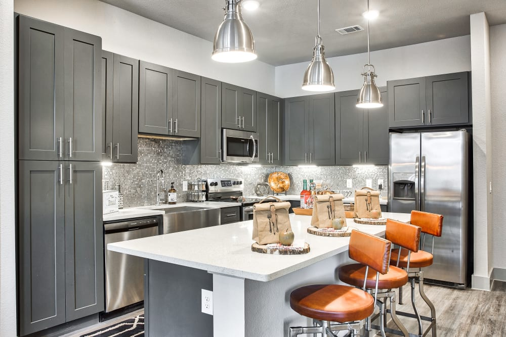 Kitchen with stainless steel appliances at Two99 Monroe in Roanoke, Texas