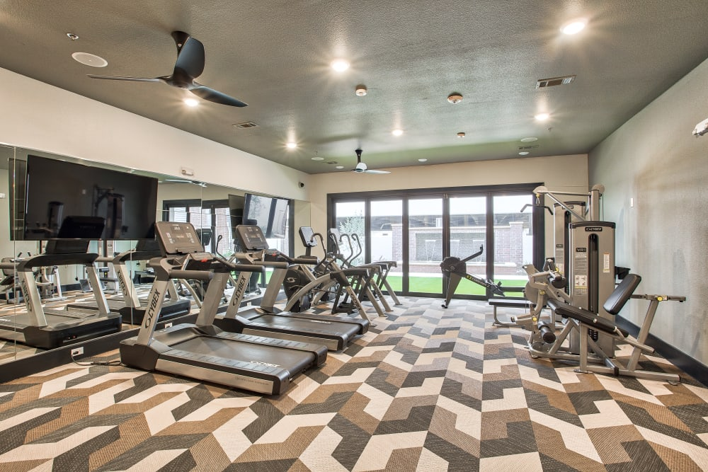 Fully equipped fitness center at Two99 Monroe in Roanoke, Texas