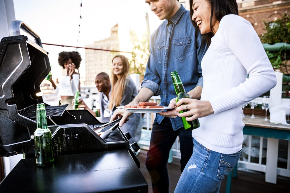 Residents grilling hot dogs at Three77 Park in Fort Worth, Texas
