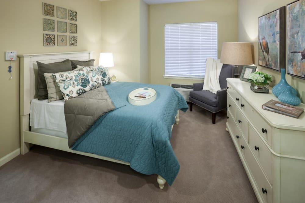 A furnished apartment bedroom at Anthology of Stonebridge Ranch in McKinney, Texas