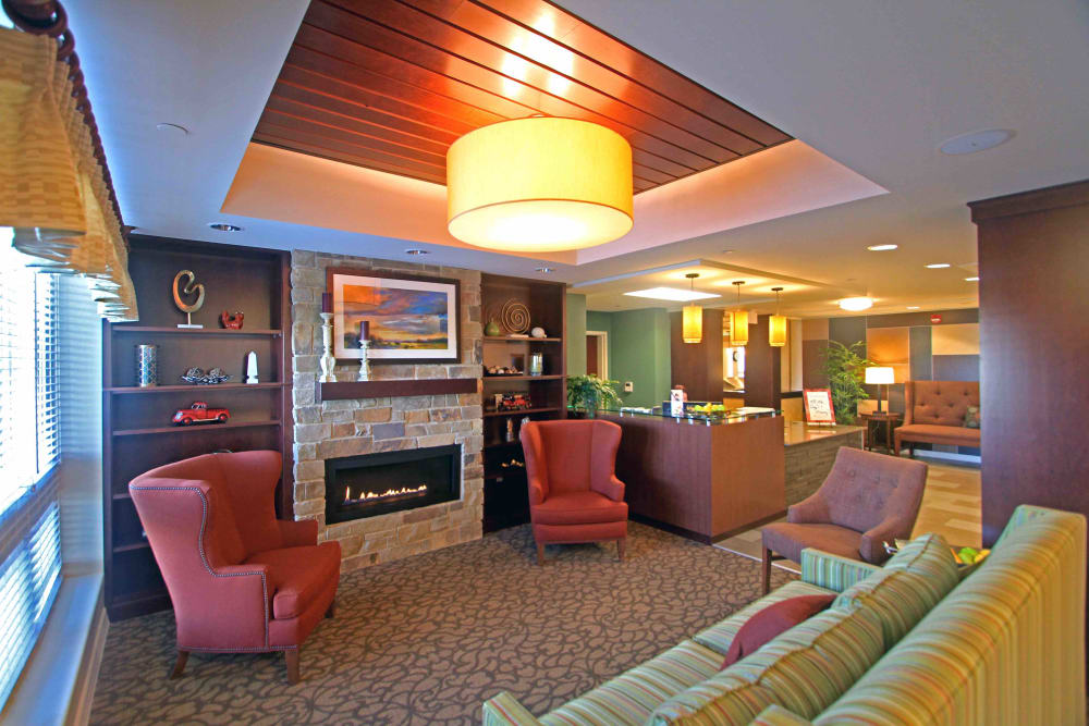 Fireside seating for residents at Anthology of Grayslake in Grayslake, Illinois