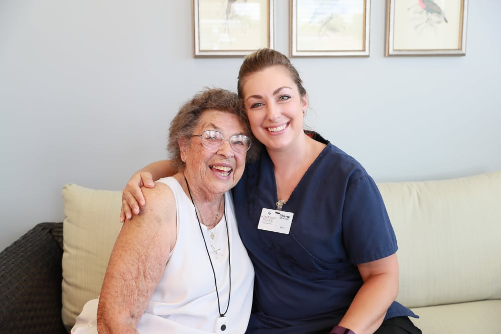 Resident and caretaker hugging at White Oaks in Lawton, Michigan