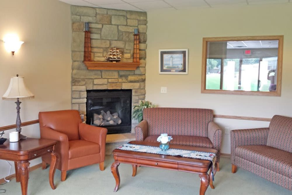Welcoming sitting room in front of a fireplace at Arbor View in Burlington, Wisconsin.
