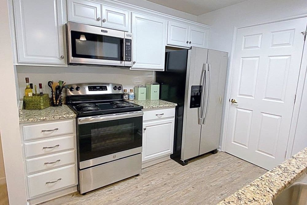 Kitchen with stainless steel appliances at Glade Creek Apartments in Roanoke, Virginia
