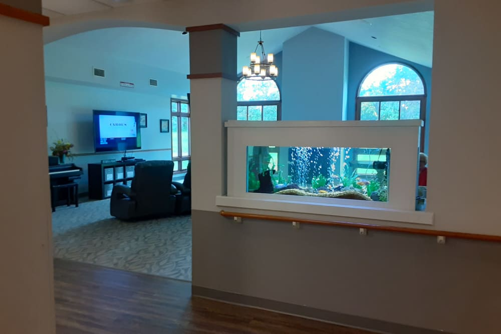 Wide hallways provide easy access to common rooms at The Atrium in Rockford, Illinois.