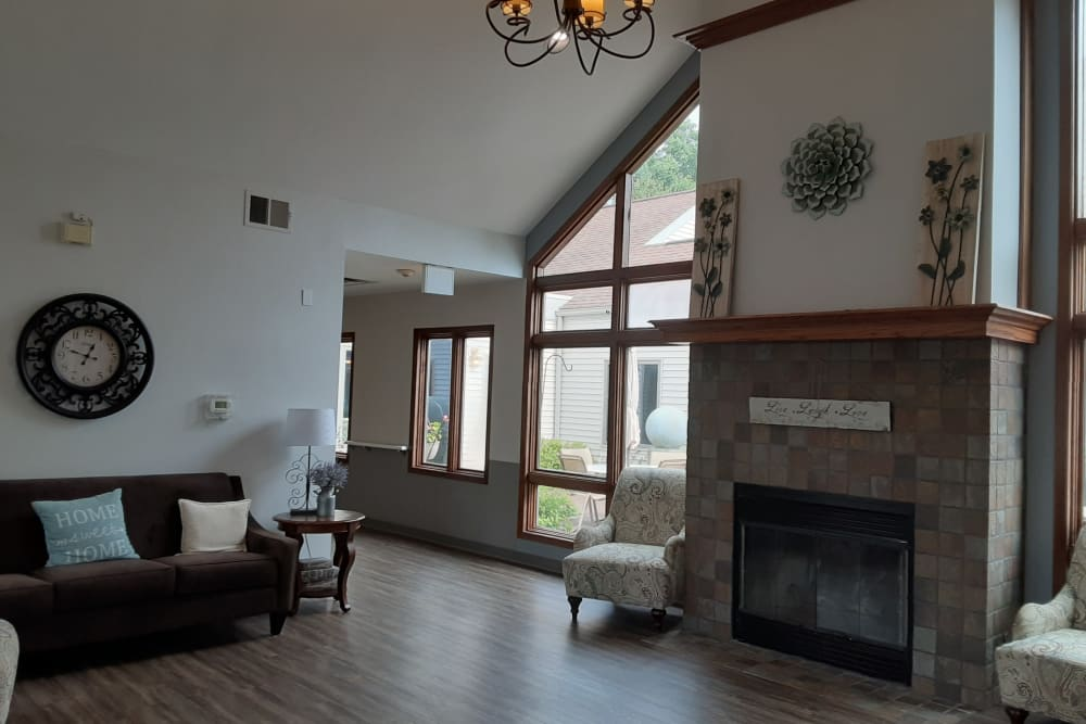 Resident sitting room with vaulted ceiling and fireplace at The Atrium in Rockford, Illinois.