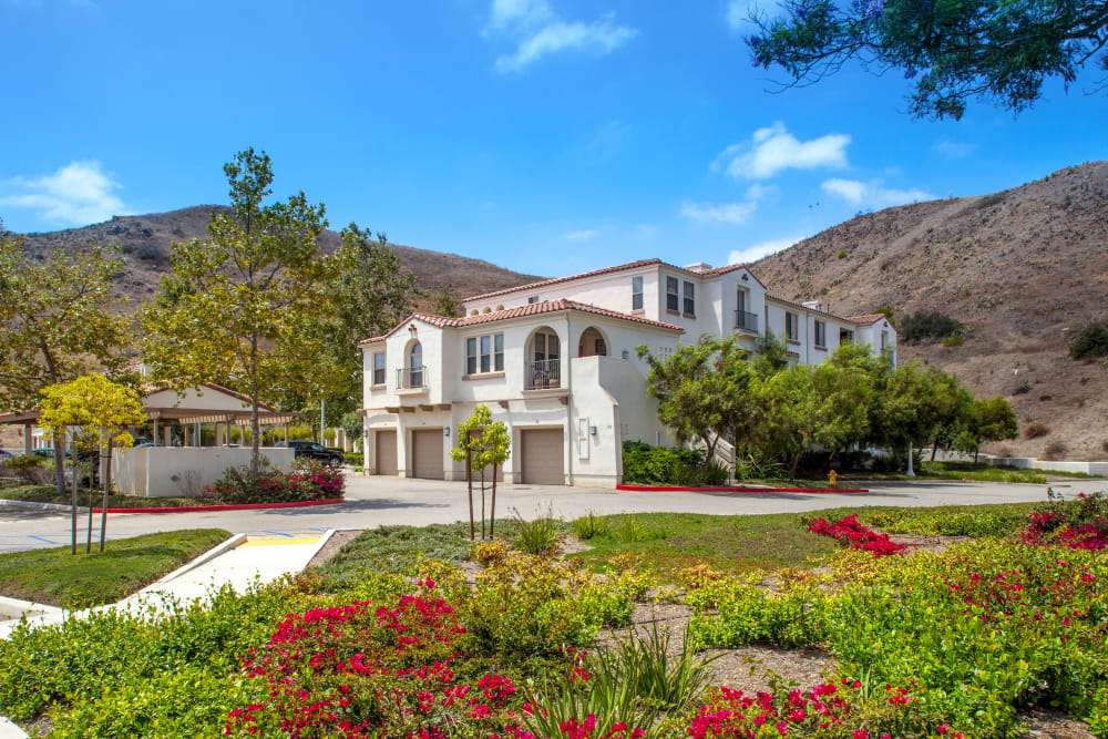 Exterior view of our mission-style community with immaculate landscaping at Mission Hills in Camarillo, California