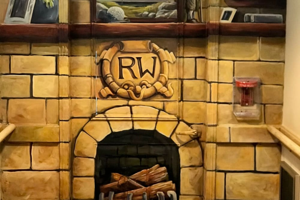 Painted fireplace wall mural at Ramsey Woods in Cudahy, Wisconsin.