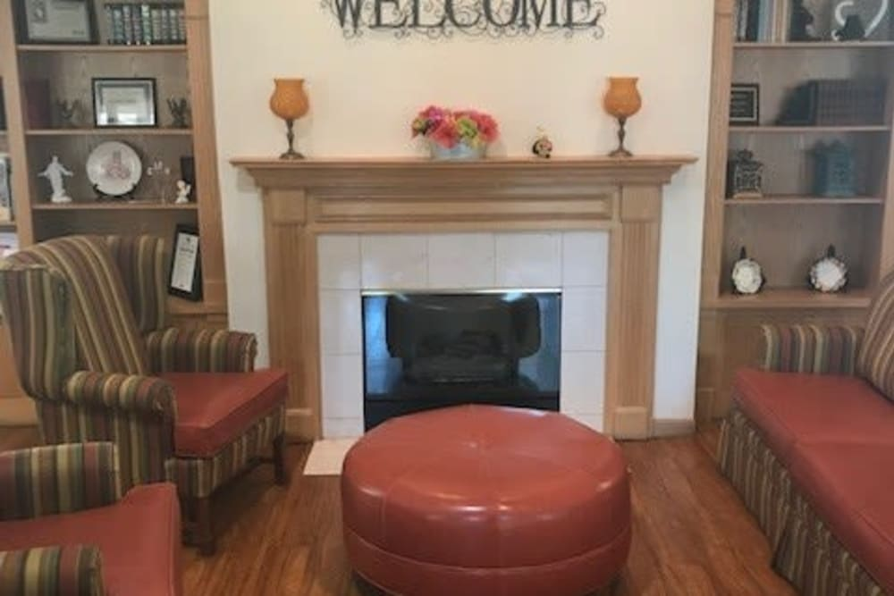 Community room with fireplace at Ramsey Woods in Cudahy, Wisconsin.
