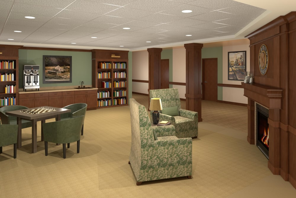 Resident library with books and seating at Willows Landing in Monticello, Minnesota.
