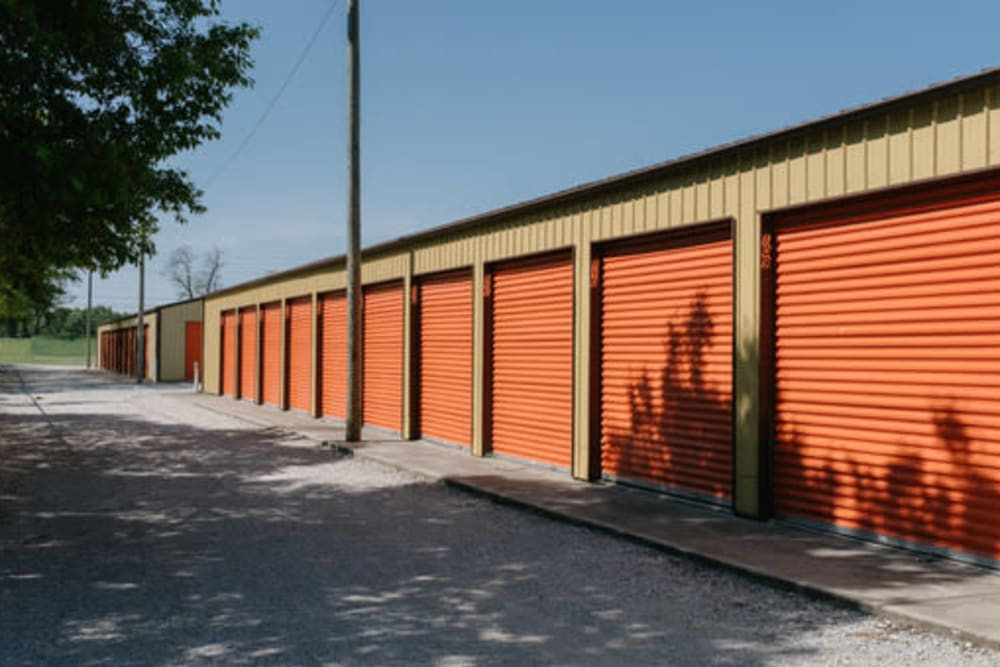 Orange unit doors off of a driveway at StayLock Storage in Wheatfield, Indiana