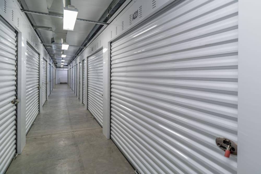 White doors on interior storage units at StayLock Storage in Hurricane, West Virginia