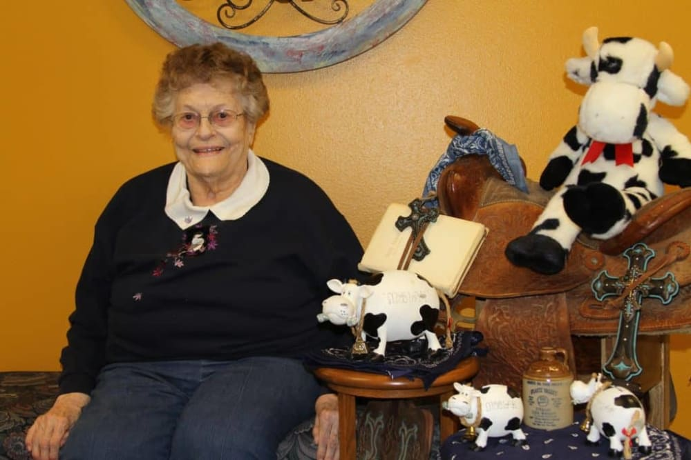 Resident with cow collection at Holstein Senior Living in Holstein, Iowa