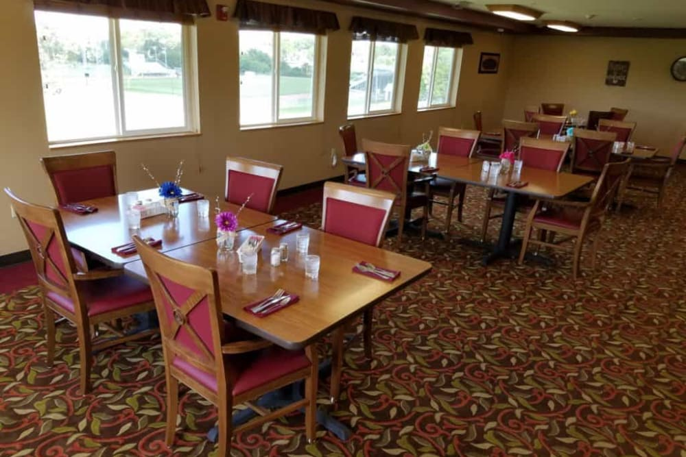 Spacious dining room with large windows at Manning Senior Living in Manning, Iowa.