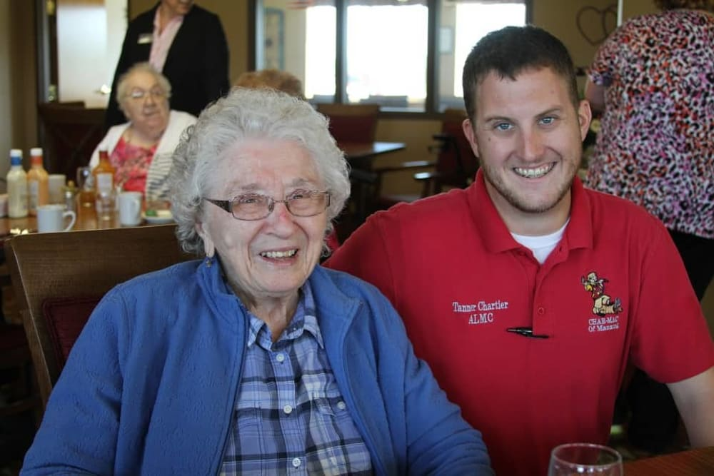 Resident and staff member enjoying dining at Manning Senior Living in Manning, Iowa.