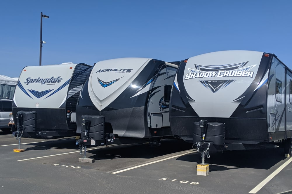 Three RVs parked side by side at Canby RV & Boat Storage in Canby, Oregon
