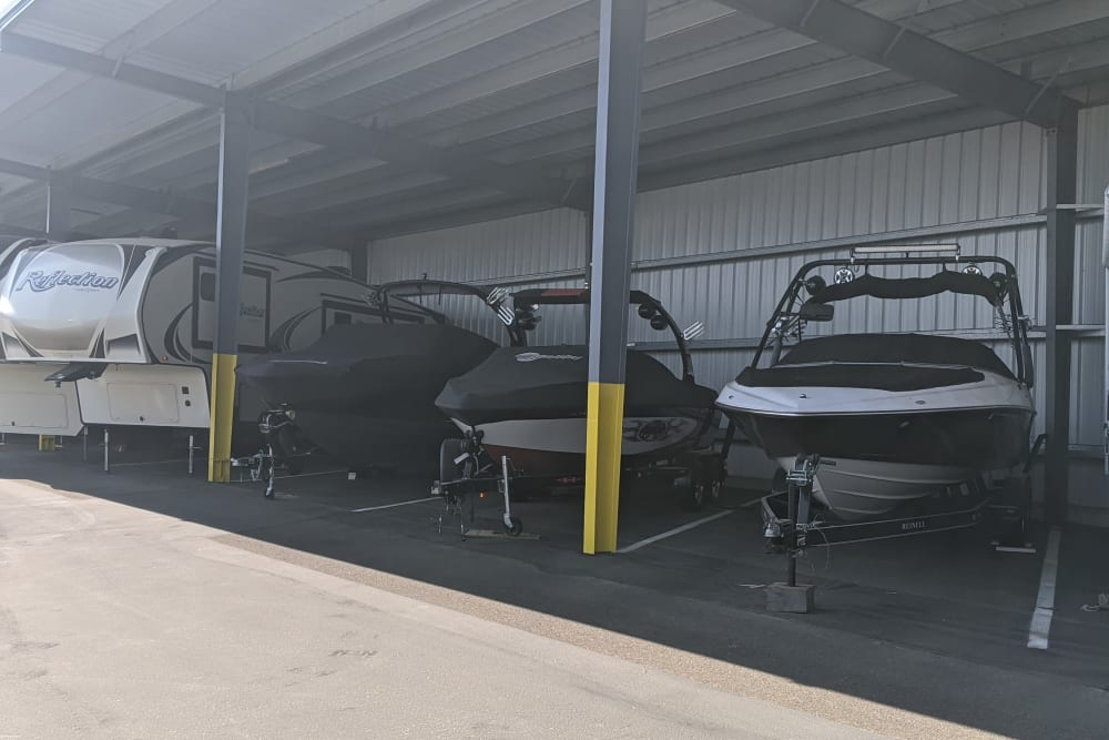 Boats parked in covered storage at Canby RV & Boat Storage in Canby, Oregon