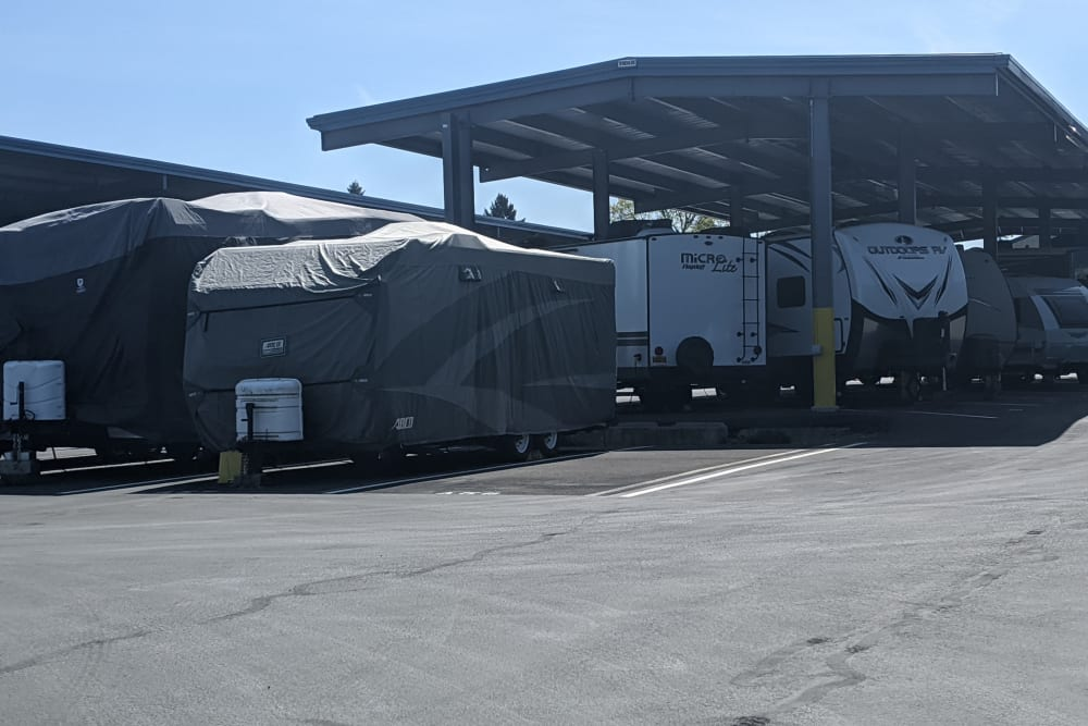 RVs covered and parked at Canby RV & Boat Storage in Canby, Oregon
