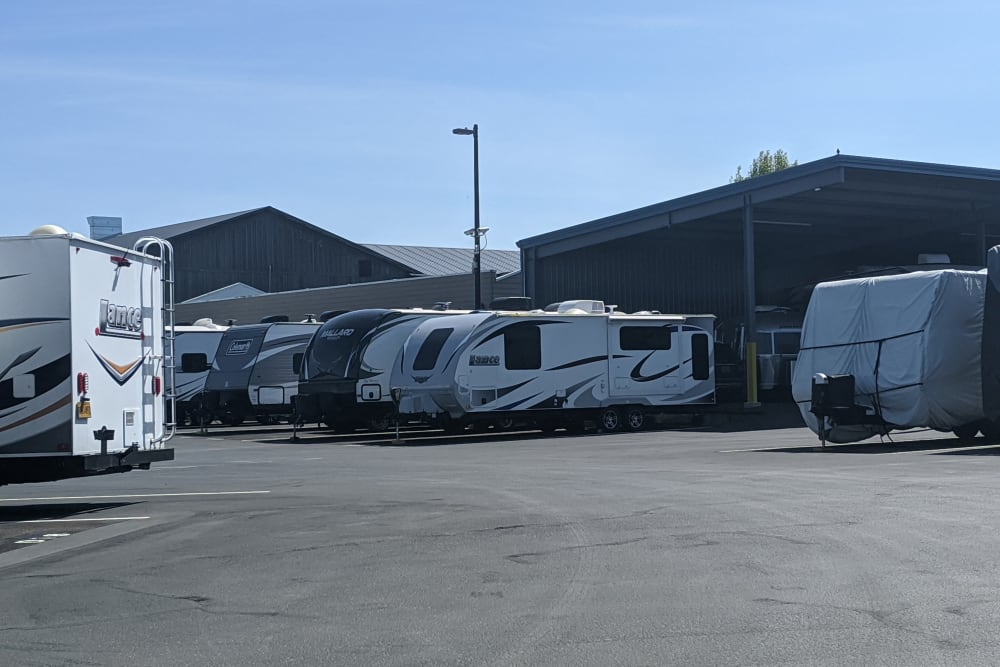 Recreational vehicles parked for storage at Canby RV & Boat Storage in Canby, Oregon