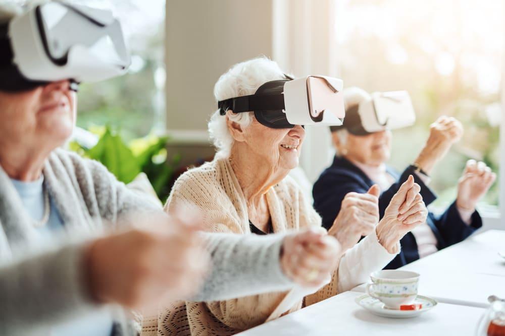 Residents enjoying virtual reality experience at Courtyard Estates at Cedar Pointe in Pleasant Hill, Iowa.