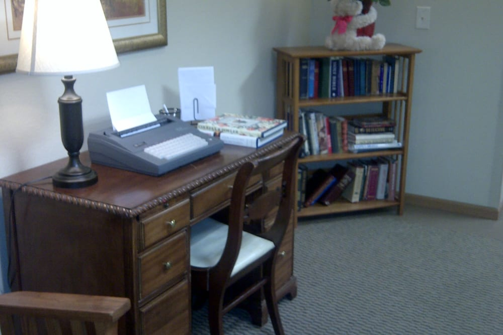 Apartment with room for desk and bookcase at Courtyard Estates at Cedar Pointe in Pleasant Hill, Iowa.