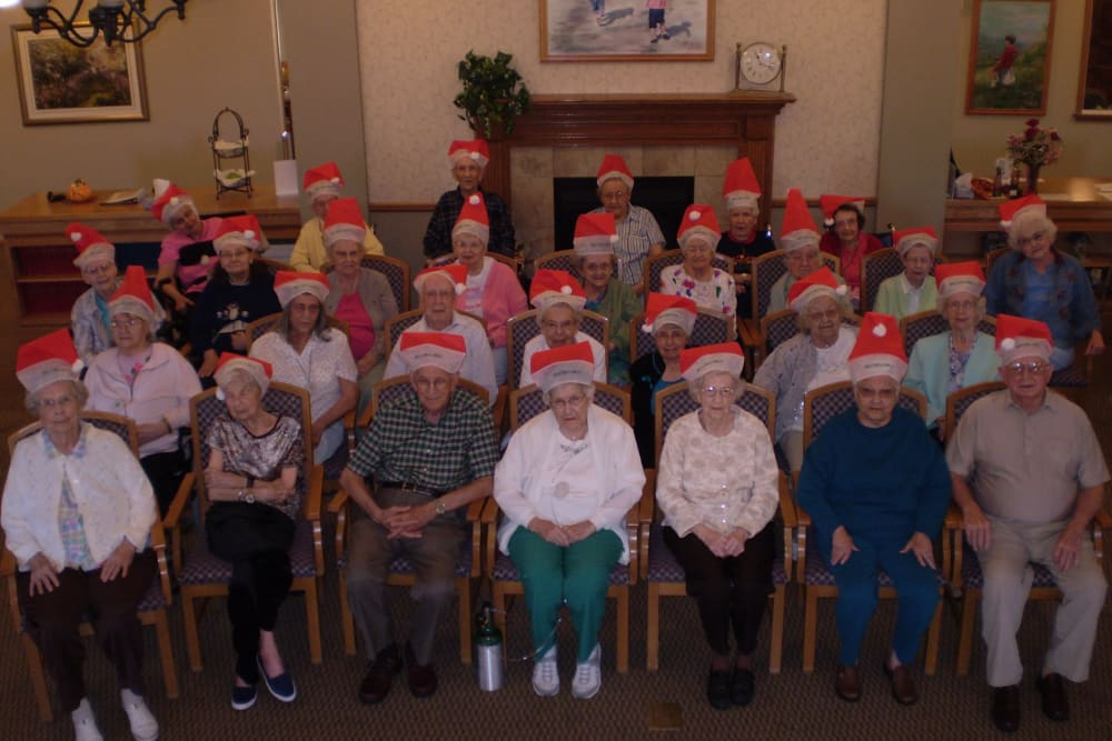 Residents in Santa hats gather for holiday photo at Courtyard Estates at Cedar Pointe in Pleasant Hill, Iowa.
