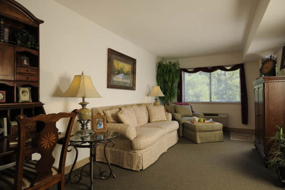 Resident living room with large windows at Willow Creek Senior Living in Elizabethtown, Kentucky.