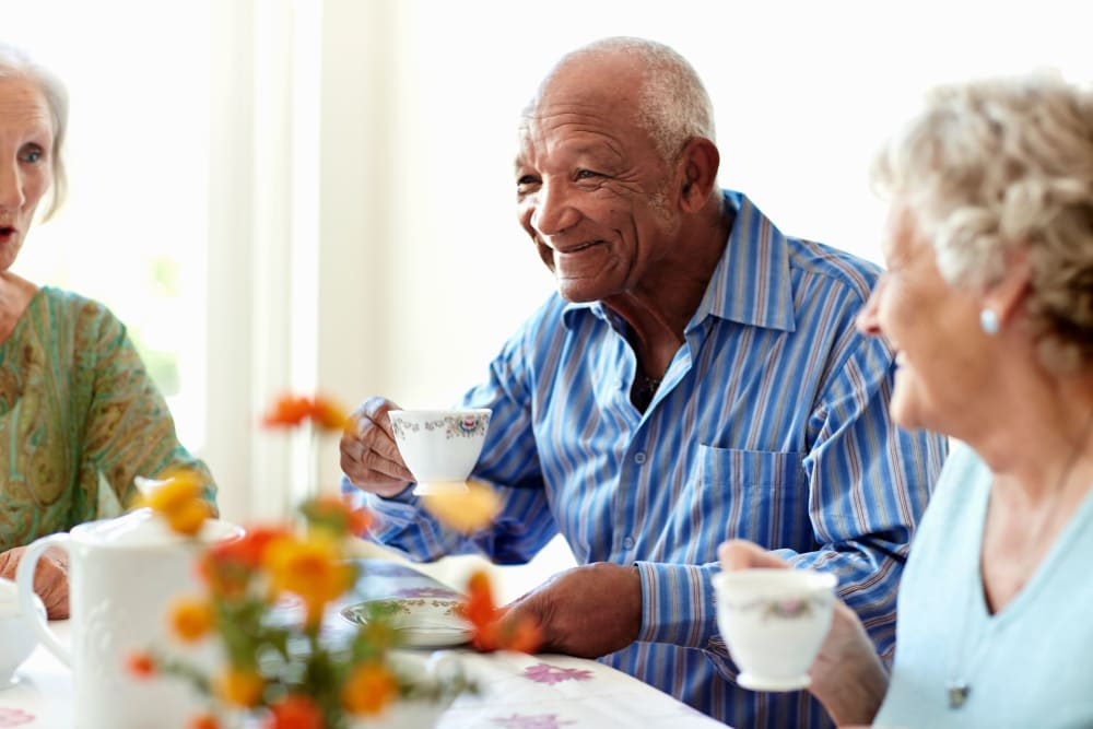 Residents sipping coffee at Avenir Memory Care Westside in Los Angeles, California.