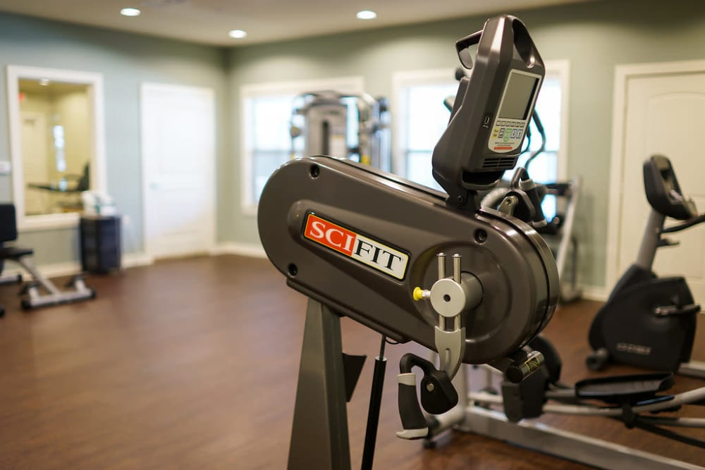 View of work out equipment in fitness gym at The Claiborne at Hattiesburg Assisted Living in Hattiesburg, Mississippi