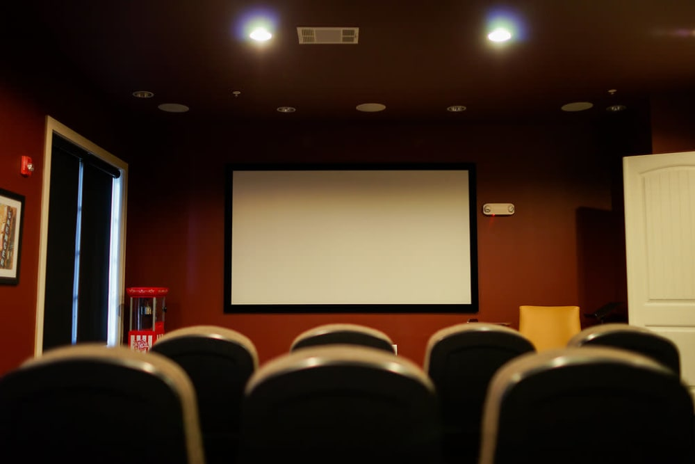 View of the screen in the indoor movie theater at The Claiborne at Hattiesburg Assisted Living in Hattiesburg, Mississippi