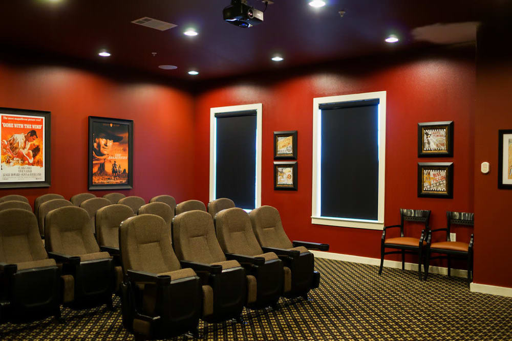View of chairs in indoor movie theater at The Claiborne at Hattiesburg Assisted Living in Hattiesburg, Mississippi