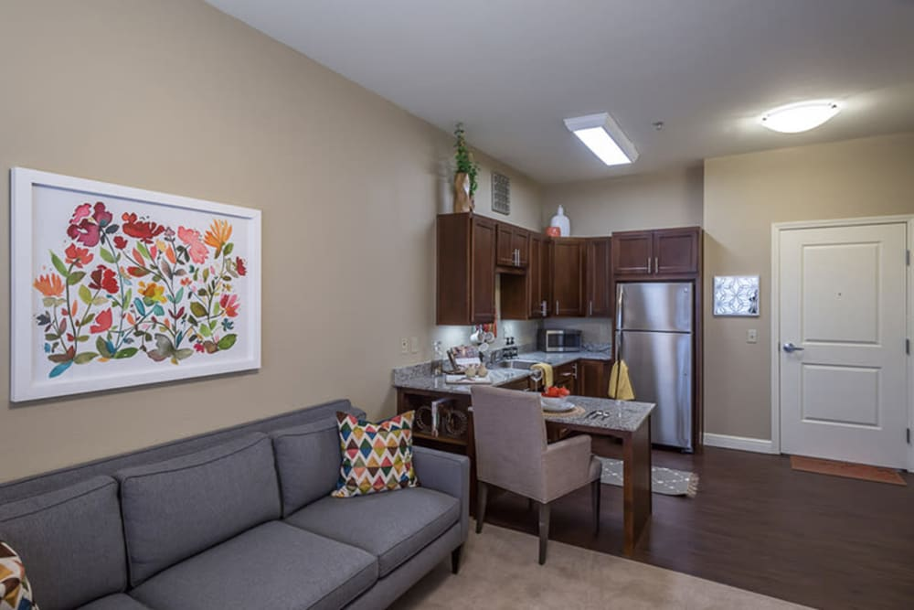 Living room with a kitchenette at Anthology of Plano in Plano, Texas.