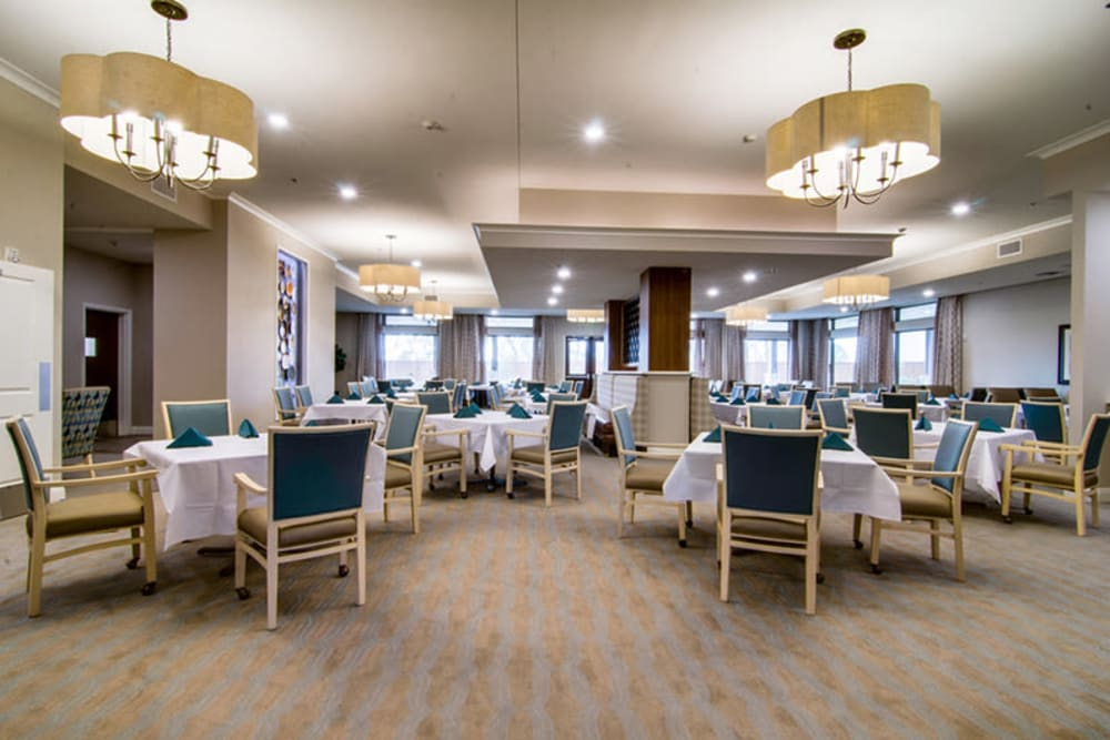 Bright resident dining room at Anthology of Plano in Plano, Texas.