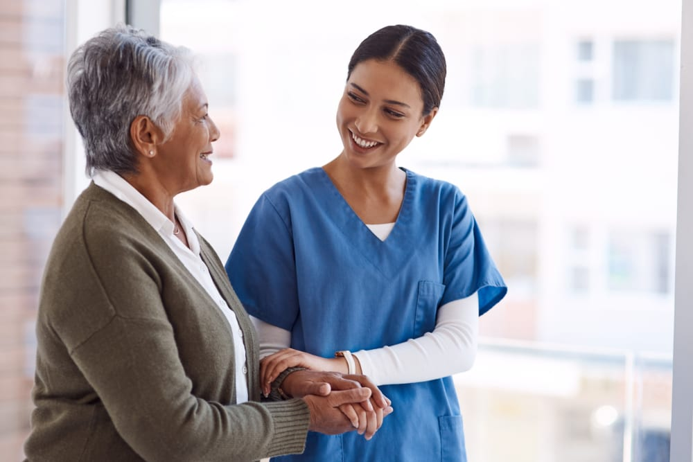 Resident consults medical staff at Carolina Assisted Living in Appleton, Wisconsin.