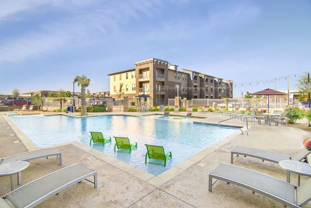 Resort-style swimming pool flanked by chaise lounge chairs at Anatole on Briarwood in Midland, Texas