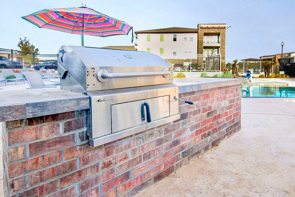 Barbecue area with a gas grill near the pool at Anatole on Briarwood in Midland, Texas