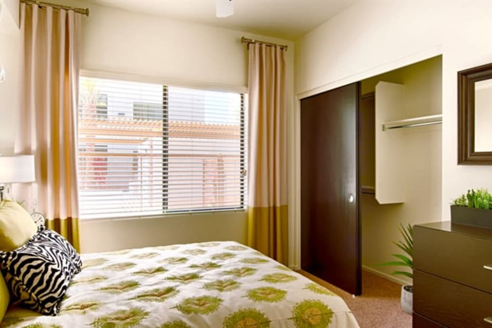 Well-furnished model home's bedroom at Cactus Forty-2 in Phoenix, Arizona
