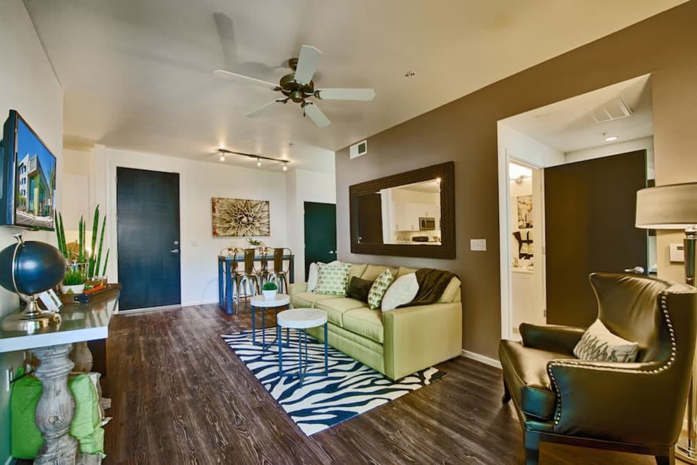 Ceiling fan and hardwood flooring in a model home's living area at Cactus Forty-2 in Phoenix, Arizona
