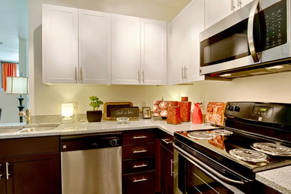 Gourmet kitchen with energy-efficient appliances in a model home at Cactus Forty-2 in Phoenix, Arizona