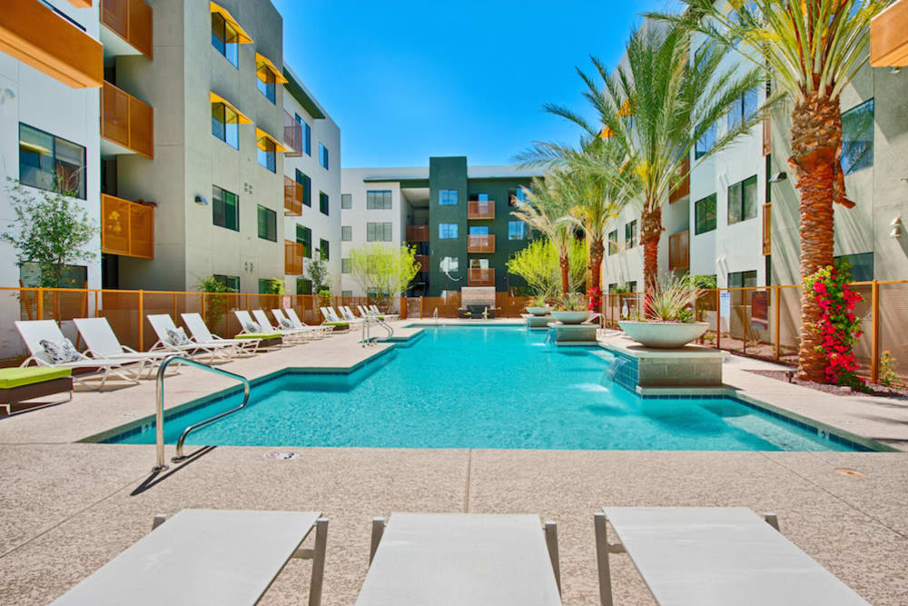 Resort-style swimming pool on a beautiful day at Cactus Forty-2 in Phoenix, Arizona