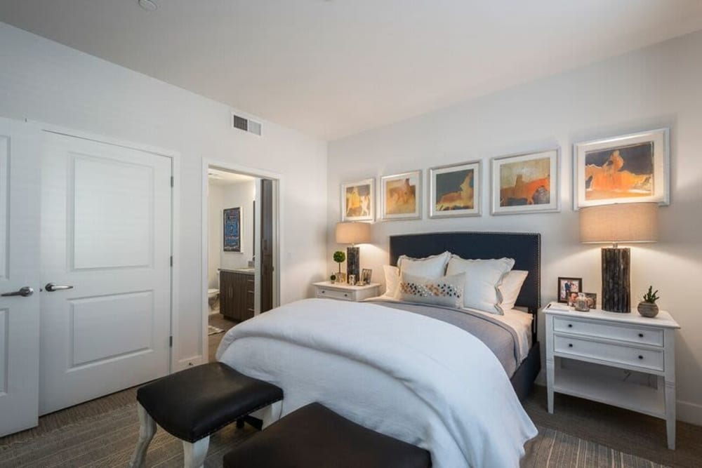 Master bedroom with plush carpeting in a model home at Cadia Crossing in Gilbert, Arizona