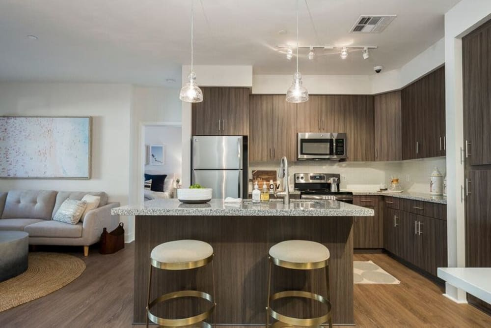 Modern kitchen with a breakfast bar in a model home at Cadia Crossing in Gilbert, Arizona