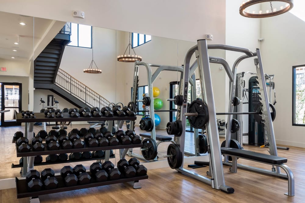 Plenty of free weights to choose from in the onsite fitness center at Cadia Crossing in Gilbert, Arizona