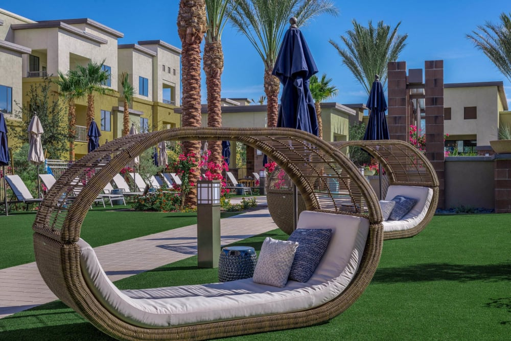 Wicker lounge chairs near the pool at Cadia Crossing in Gilbert, Arizona