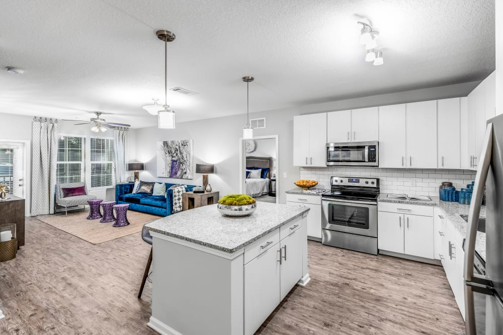 Beautifully designed open-concept layout with hardwood flooring in a model home at Canopy at Citrus Park in Tampa, Florida